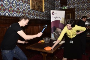 Alison Thewliss is hammered by an assistant to celebrate the Royal Society of Chemistry's 175th Anniversary