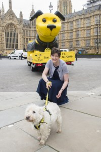Alison Thewliss petting a dog at the launch of the Dogs Trust ad campaign