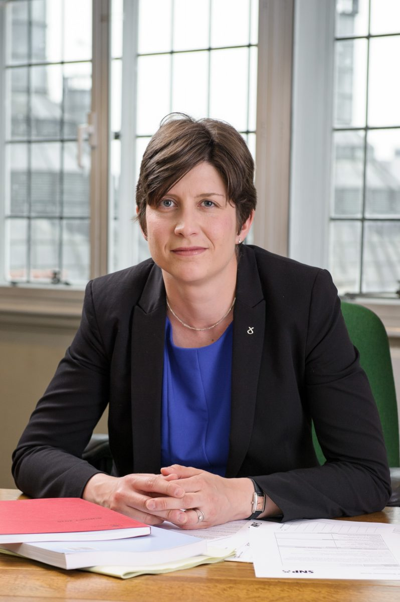 Alison Thewliss MP sitting at her desk in Parliament